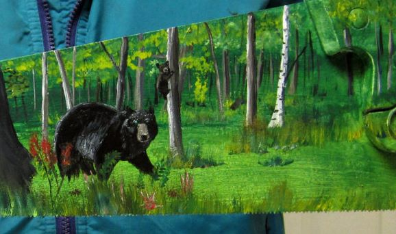 Image of Bear painted on saw.