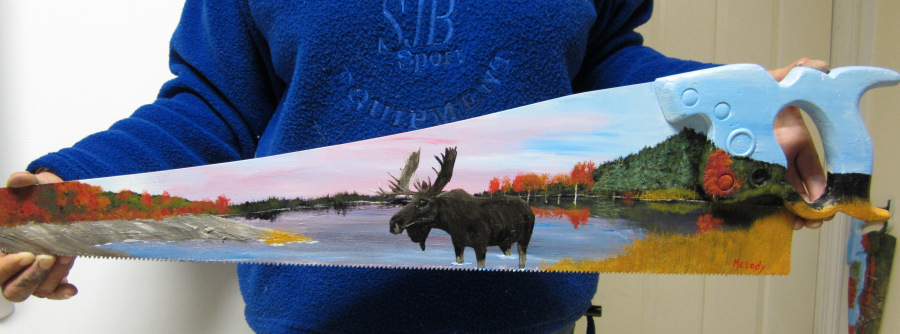 Image of Moose painted on saw.