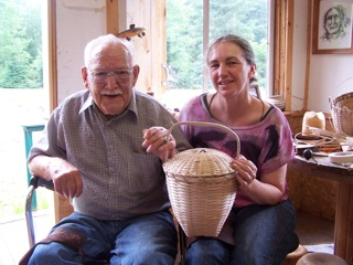 Image of Sherry Gould with one of her baskets.