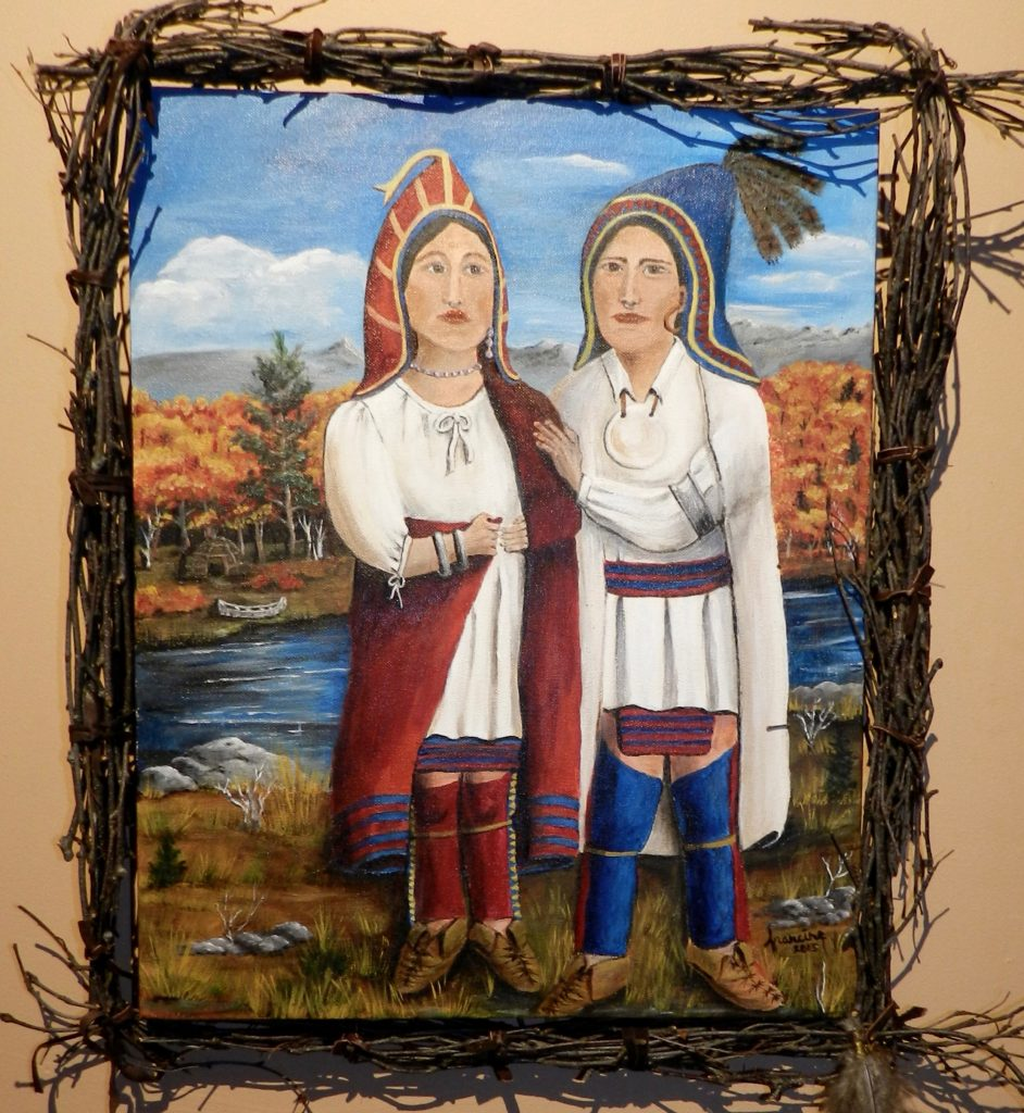Brightly colored acrylic painting of an Abenaki man and woman standing outdoors, near a river,amd they are wearing historical Abenaki clothing. They are both wearing peaked hoods, white linen shirts are white linen ,and their bottoms are blue and red wool.