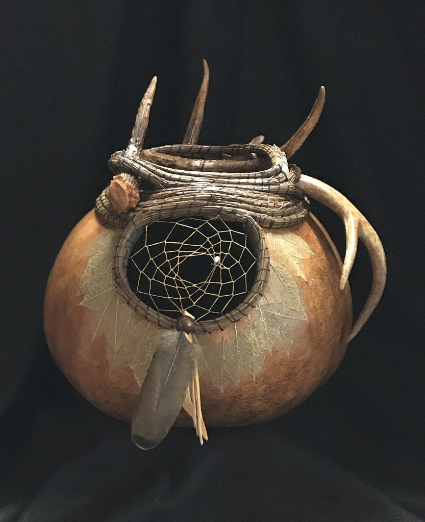 Image of gourd with dreamcatcher.