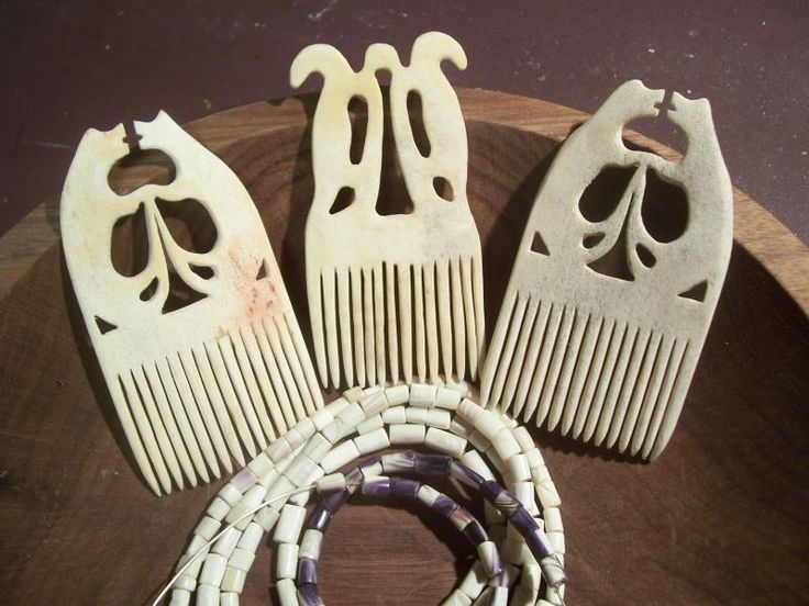 Image of Carved  Bone Combs.