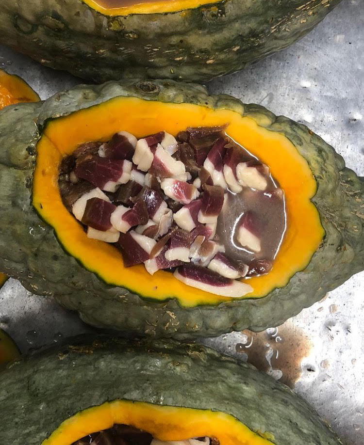 Image of Jacobs cattle beans, cured duck breast ham, and maple syrup backed in Blue Hubbard squash.