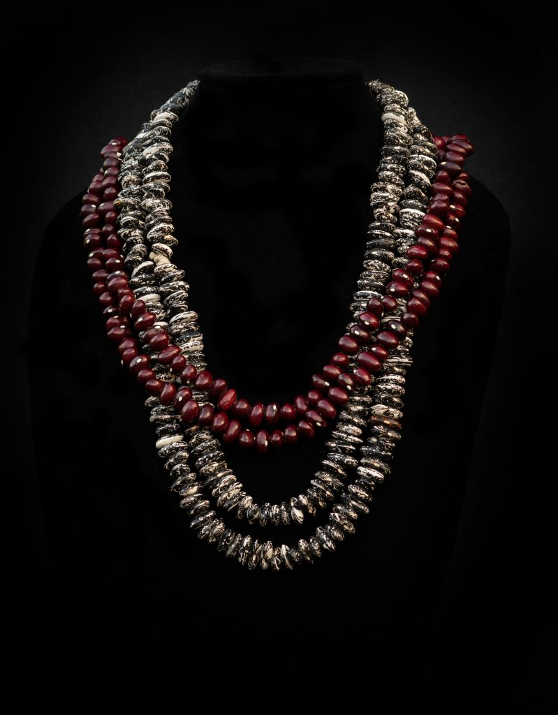 Image of cranberry and skunk bean necklace